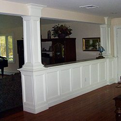Paneled wainscot divider with built-in cabinet & column