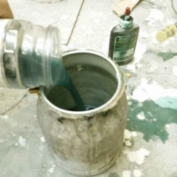 Lacquer with the addition of green dye will shift the color of the wood away from red.